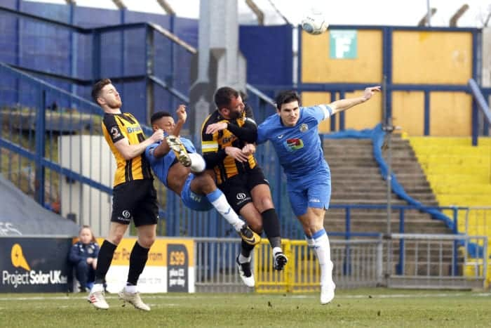Nyal Bell and Ash Palmer go for goal for Stockport
