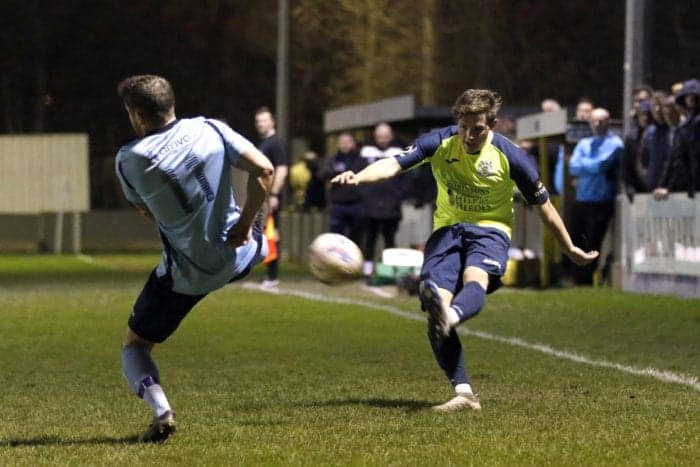 Josh Robinson crosses the ball for Stockport