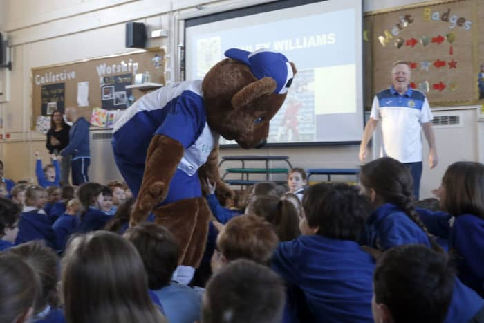Stockport County Mascot, Vernon Bear, meeting some All Saints Marple school students during a Healthy Eating presentation