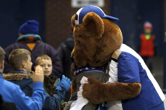 Vernon Bear hugging a Stockport County Fan