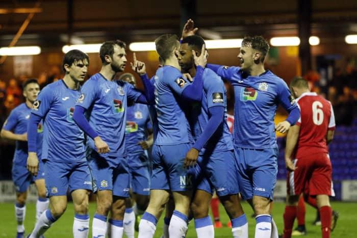 The Stockport County team celebrate Nyal Bell's opening goal against Ashton United.
