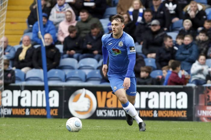 Jamie Stott on the ball for Stockport County