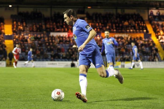 Sam Walker on the ball against Ashton United.