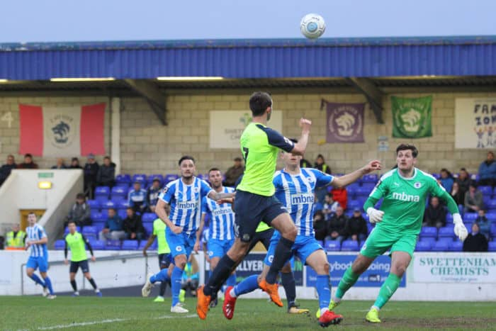 Adam Thomas heads the ball to Nyal Bell, who scores.